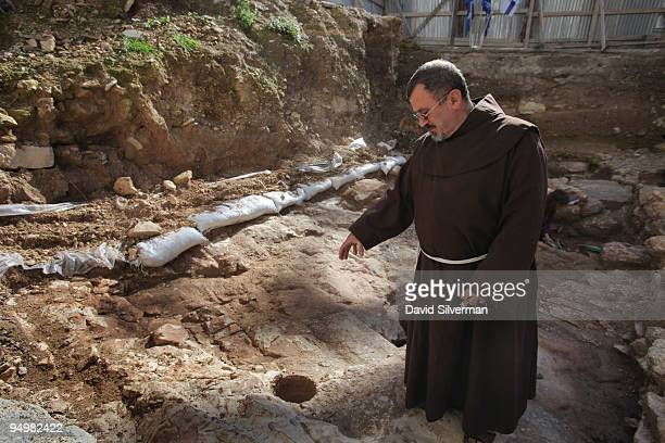Father Jacques Karam a catholic priest from the neighbouring Church of the Annunciation visits the archaeological excavation which reveals for the...
