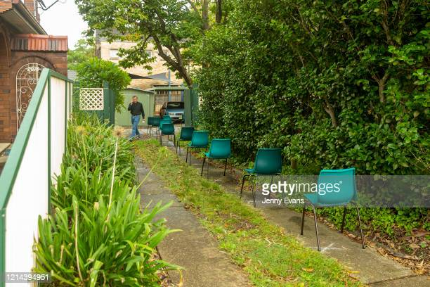 Father James Collins is seen by seating observant of social distancing at St Paul's Anglican Church in Burwood on March 24 2020 in Sydney Australia...