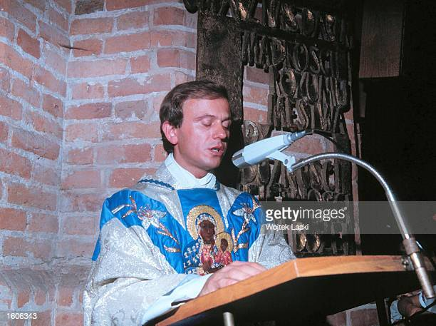 Father Jerzy Popieluszko one of the leaders of Solidarnosc the Polish antitotalitarian movement of 1980''s stands at a lectern in this file photo...