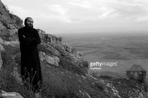 Father Joaqim stands overlooking Syria and the Mesopatamian plain from Mor Augen an ancient Syriac Orthodox Monastery situated on the southern slope...