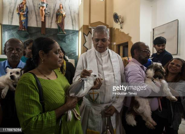 Father Joe Dsouza blesses pets at St John the Evangelist Church at Fort on October 13 2019 in Mumbai India