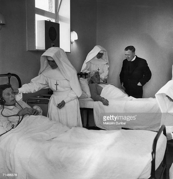 Father John Morrison visits the nuns and patrients at the infirmary on the island of South Uist in the Outer Hebrides 15th October 1955 Original...