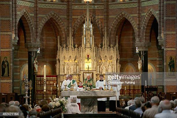 Father Julius Dresme conducts a special mass in Saint Vitus Church in memory of the victims of Malaysia Airlines flight MH17 on July 20 2014 in...
