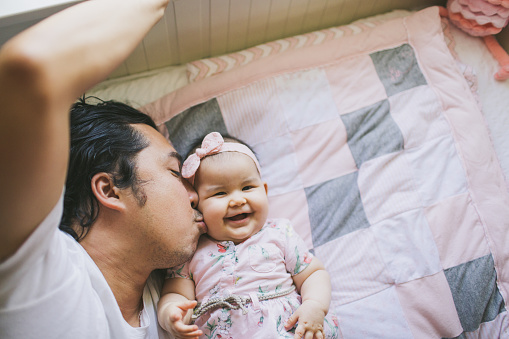Father kissing baby girl - gettyimageskorea