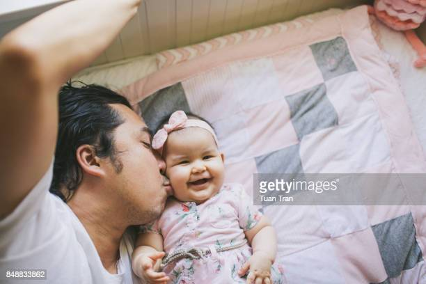 father kissing baby girl - single father stock pictures, royalty-free photos & images