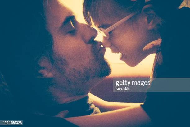 father kissing daughter on nose - ivanjekic stock pictures, royalty-free photos & images