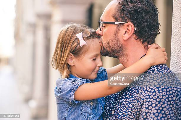 Father Kissing His Daughters Forehead
