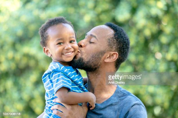 Father Kissing Young Son