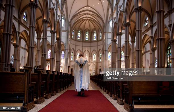 Father Kris Stubna walks to the sanctuary following a mass to celebrate the Assumption of the Blessed Virgin Mary at St Paul Cathedral the mother...