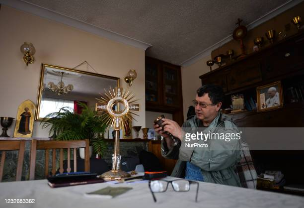 Father Krzysztof Sikora checks the liturgical vessels used during the celebration of the Holy Mass inside the presbytery in Roundstone....