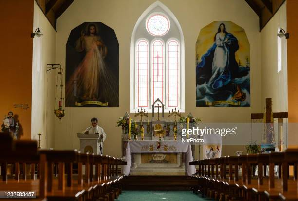 Father Krzysztof Sikora during a private prayer at the closed and empty Roman Catholic Church 'Our Lady Star Of The Sea' in Roundstone. Due to...