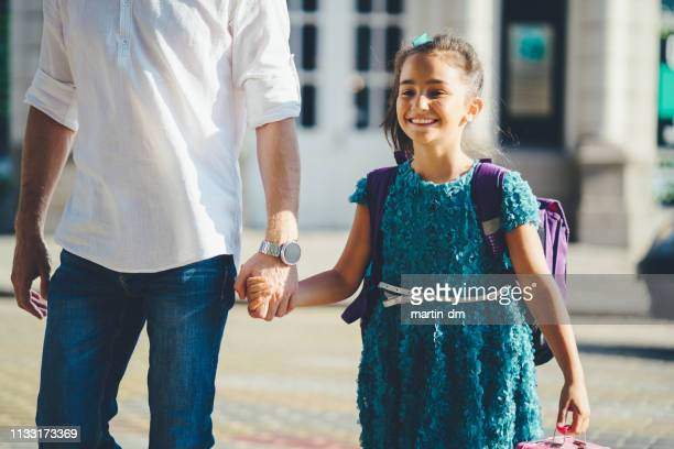 father leads his daughter to school - picking up stock pictures, royalty-free photos & images