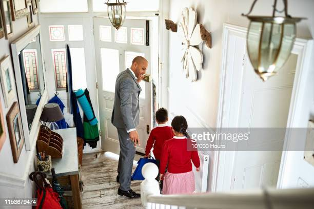 father leaving for work with two school children - leaving stock pictures, royalty-free photos & images
