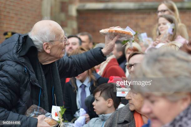 Father Leon Knabit a Polish Benedictine distributes the Easter bread to the crawd at the end of the blessing of Easter foods ceremony outside...