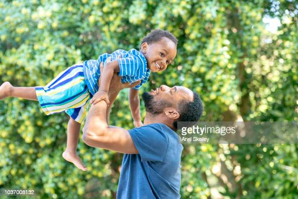 Father Lifting 2 Year Old Son
