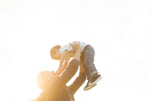A father lifting his son - gettyimageskorea