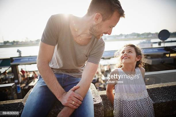 father looking at daughter in backlight - sleeveless top stock pictures, royalty-free photos & images