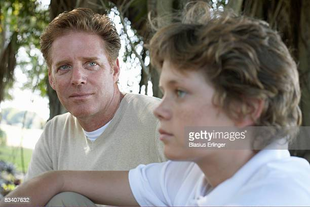 father looking at teen son - blasius erlinger stock pictures, royalty-free photos & images