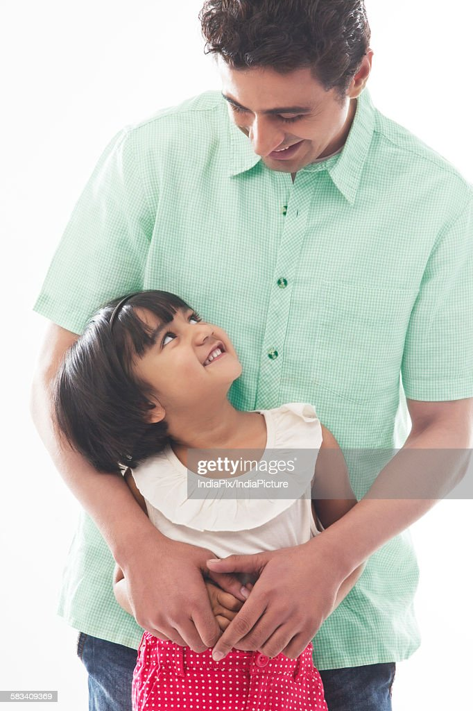 Father looking down at his daughter : Stock Photo