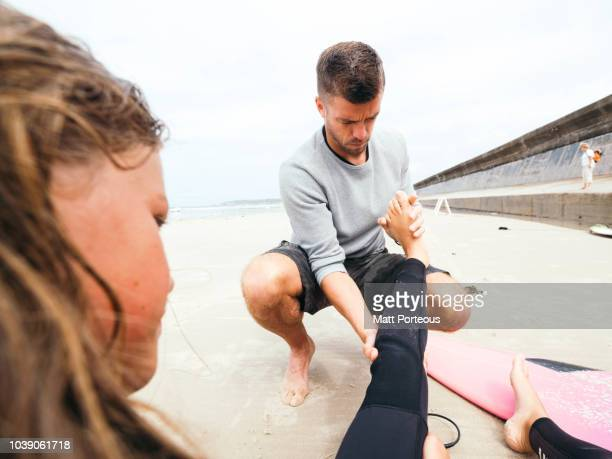 Father looks at surf injury
