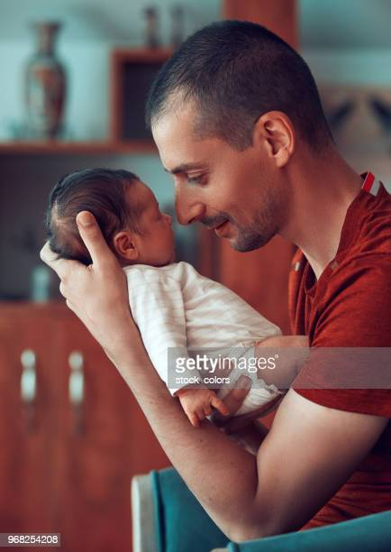 father loving his baby girl - differential focus stock pictures, royalty-free photos & images