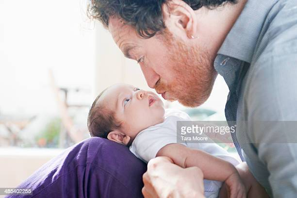 father making funny face to baby - pulling funny faces stock pictures, royalty-free photos & images