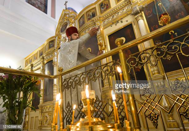 Father Marcin seen during the Bright Resurrection of Christ liturgy on Sunday morning inside the Orthodox Church of the Assumption in Krakow. On...