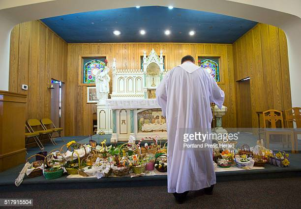 Father Mariusz Lis blesses Easter baskets with holy water at St Louis Church on Saturday March 26 2016 wiconka the blessing of Easter baskets is a...