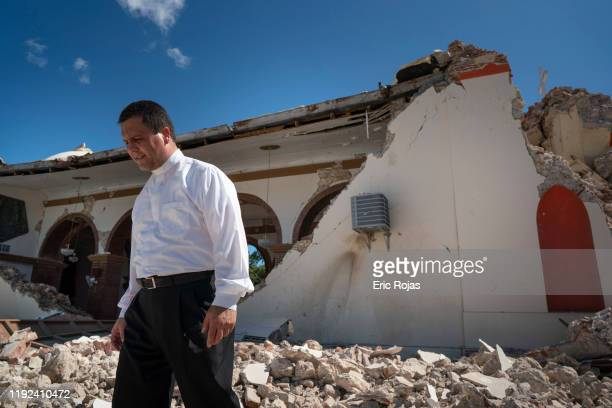 Father Melvin Diaz Aponte inspects damage to the Parroquia Inmaculada Concepción church after a 64 earthquake hit just south of the island on January...