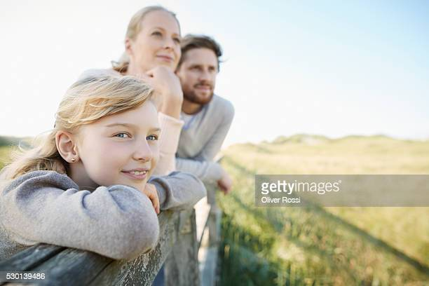 Father, mother and daughter at the coast