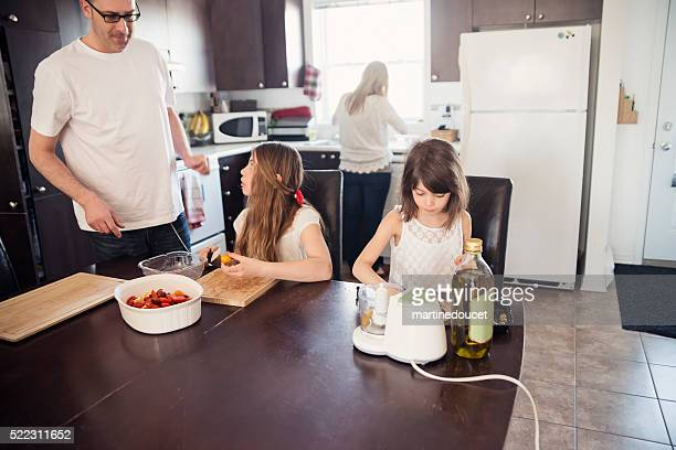 "father, mother and daughter preparing meal in home kitchen. - ""martine doucet"" or martinedoucet bildbanksfoton och bilder"