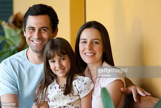 Father, mother and daughter together