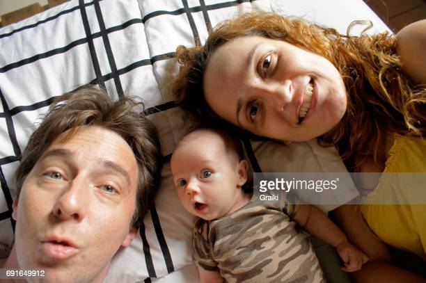 Father, Mother and newborn daughter in a selfie.