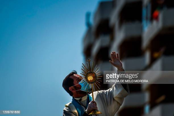 Father Nuno Westood prays for the faithful fulfilling the duty to stay at home on Easter Sunday due to the coronavirus COVID-19 outbreak in Oeiras in...