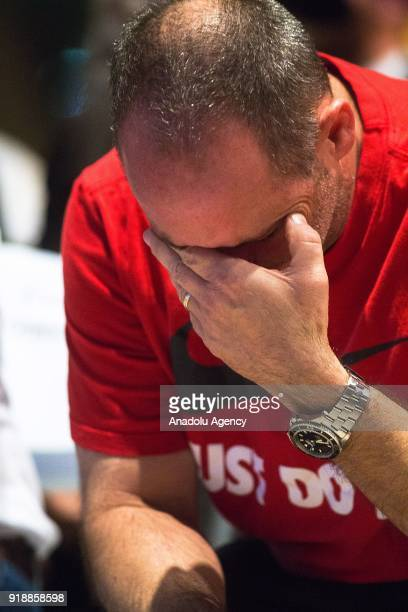 Father of 14 yearold mass shooting victim Fred Guttenberg cries as people gather at Pine Trails Park during a commemorative ceremony held for 17...
