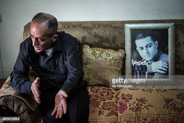 Father of 19yearold Muhammad Musallam an Israeli Arab executed by Islamic State in Syria sits in his home on March 11 2015 in East Jerusalem Israel...
