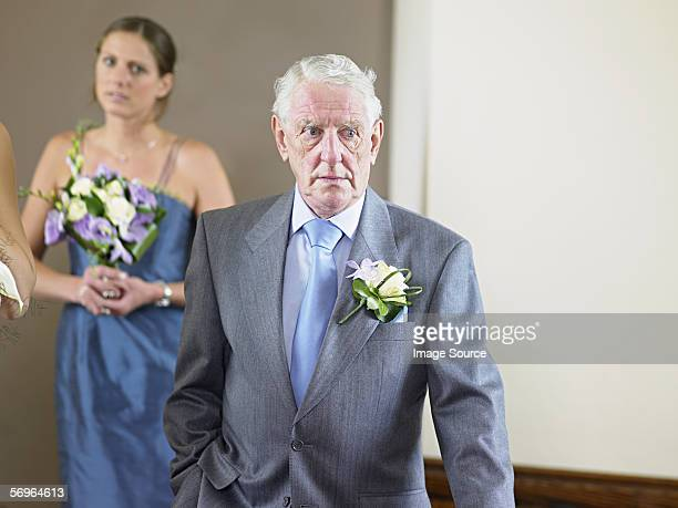 Father of bride by bridesmaid