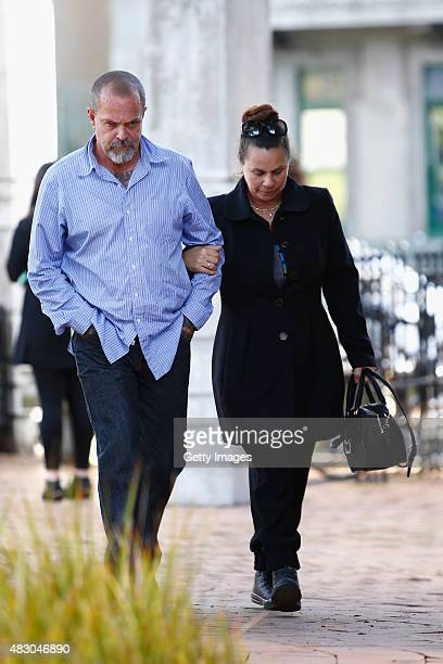Father of Connor Morris Head Hunters associate Chris Morris and his wife Julie Morris arrive at the Auckland High Court on August 6 2015 in Auckland...