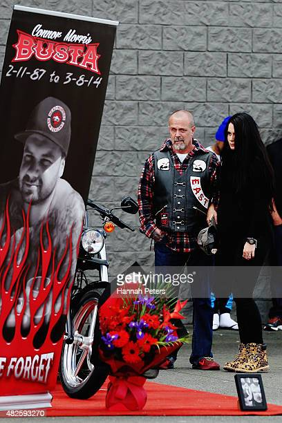 Father of Connor Morris Head Hunters associate Chris Morris looks at a memorial with former partner of Connor Millie ElderHolmes on August 1 2015 in...