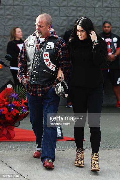 Father of Connor Morris Head Hunters associate Chris Morris walks past a memorial with partner Millie ElderHolmes on August 1 2015 in Auckland New...