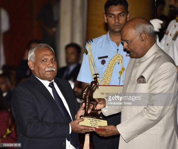 Father of Late Ravi Kumar receives the Tenzing Norgay National Adventure Award 2017 for his achievements in Mountaineering from President Ram Nath...