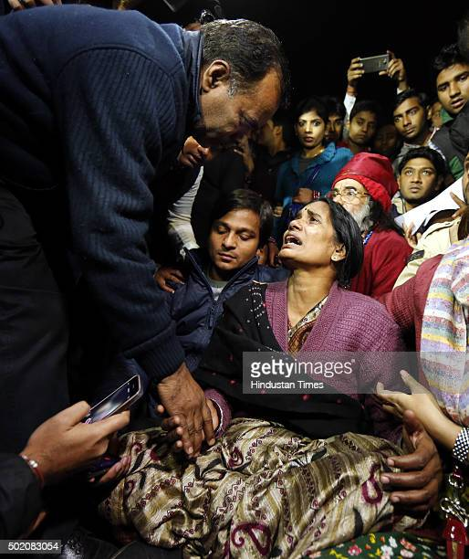 Father of Nirbhaya consoles her mother as she broke down during a protest against the release of juvenile convict of the 16 December gangrape along...