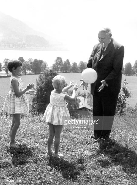 Father of the 'German economic miracle' Ludwig Erhard plays ball with his two grandchildren Susanne and Sabine in the summer of 1959