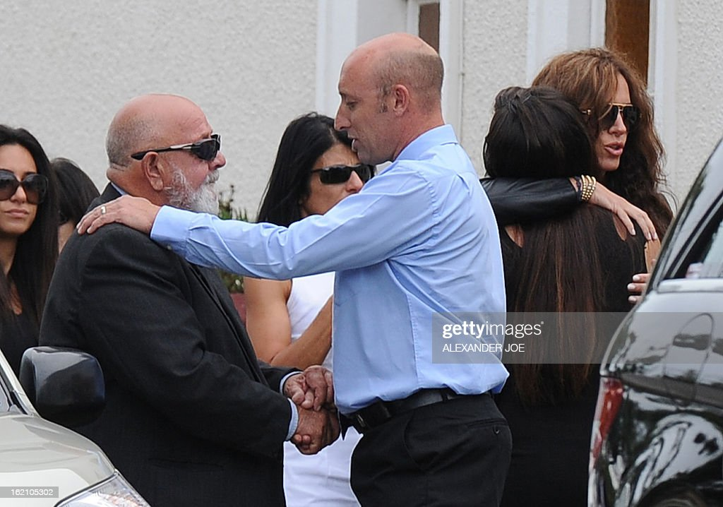 Father of the late South African model Reeva Steenkamp Barry Steenkamp (2L) arrives at the crematorium building in Port Elizabeth on February 19, 2013 after Steenkamp, 29, was shot four times in the early hours of February 14, by a 9mm pistol owned by South African sporting hero Oscar Pistorius. South African prosecutors on Tuesday told a bail hearing that Oscar Pistorius was guilty of 'premeditated murder' in the Valentine's Day killing of his model girlfriend at his upscale home.