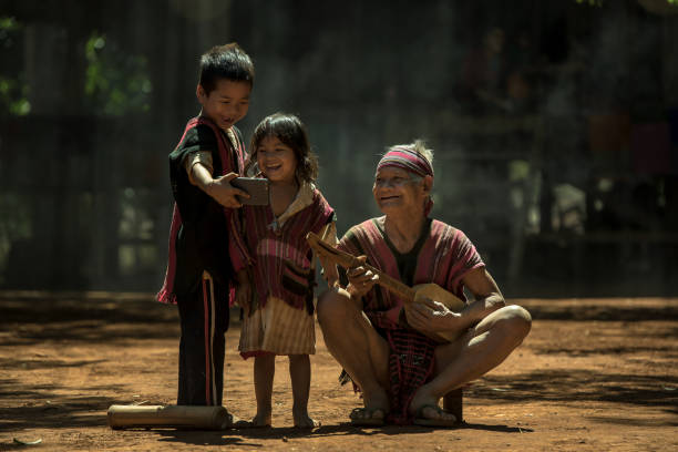 Father Of Three Children Are Enjoying Playing Music And Phone