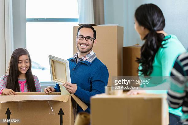 Father packs belongings in box