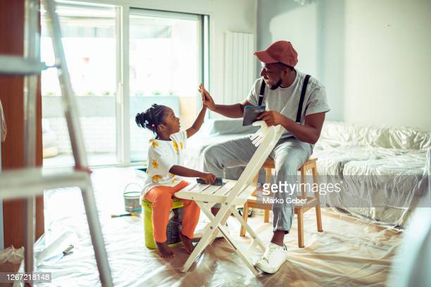 father painting a chair with his daughter - service stock pictures, royalty-free photos & images