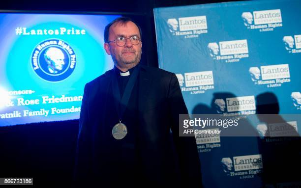 Father Patrick Desbois stands after being awarded the Lantos Human Rights Prize during a ceremony on Capitol Hill in Washington, DC, on October 26 to...