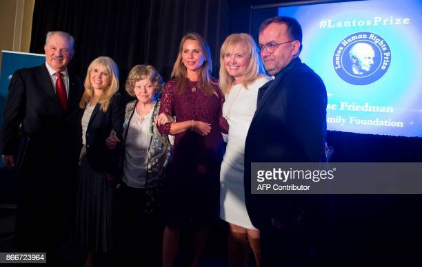 Father Patrick Desbois stands alongside Phil Friedman of the Lantos Foundation Annette Lantos Tillemann Dick Annette Tilleman CBS News Chief Foreign...