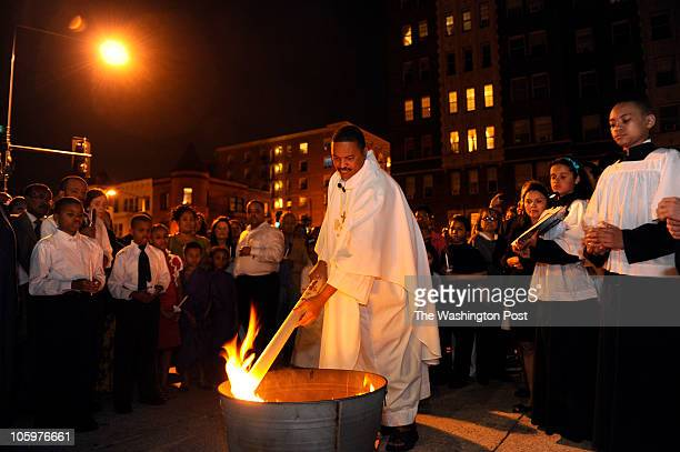 Father Patrick Smith begins the Holy Saturday Vigil of the Lord's Resurrection outside of St Augustine's Catholic Church at 15th and V Streets...